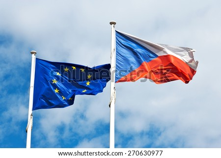 EU and Czech flag against the sky in the wind - stock photo