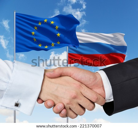 EU and Russian agreement, on a blue sky background.  - stock photo