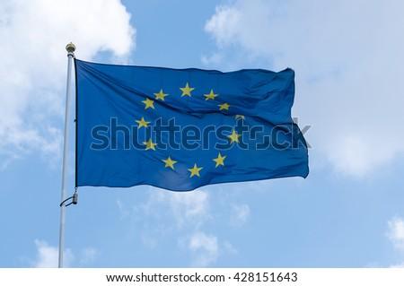 EU Flag and blue sky - stock photo