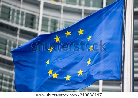 EU flag close up in front of Berlaymont building - stock photo