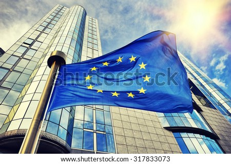 EU flag waving in front of European Parliament building. Brussels, Belgium - stock photo