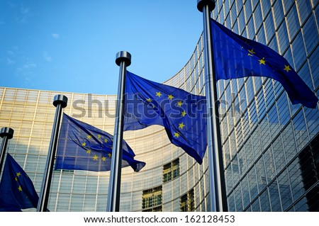 EU flags in front of European Commission in Brussels - stock photo