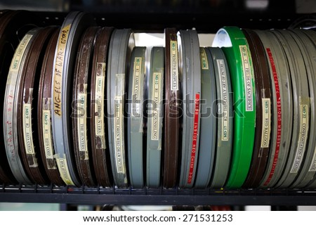 EUGENE, OR - APRIL 10, 2015: Film reels for a cinema studies class on shelves in a video library. - stock photo