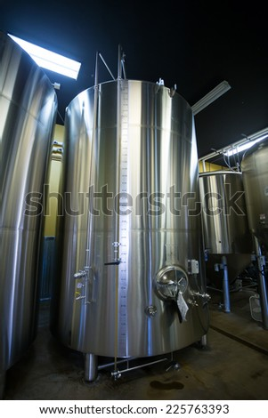 EUGENE, OR - JULY 17, 2014: Stainless steel fermenters in the brewing room at Oakshire Brewery, a small craft beer maker in the Northwest. - stock photo