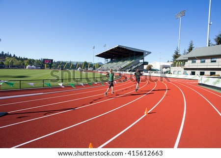 EUGENE, OR - MAY 1, 2016: Runner completing the final turn on the track at Hayward Field during the 2016 Eugene Marathon, a Boston qualifying event. - stock photo