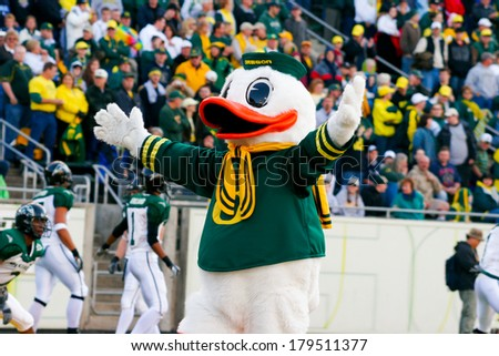 EUGENE, OR - OCTOBER 28, 2006: Oregon duck mascot Puddles holds his arms wide to the crowd at the start of the UO vs PSU football game at Autzen Stadium. - stock photo