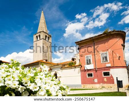 Euphrasian Basilica in Porec, Istria, Croatia. UNESCO World Heritage. Medieval Mediterranean City. Popular Tourist Resort at Adriatic Sea. Copy Space. - stock photo