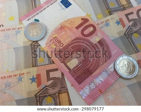 EUR notes and coins - stock photo