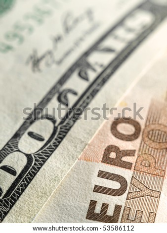 Euro and dollar money bills ,closeup image with shallow DOF, useful for various financial,economic or exchange themes - stock photo
