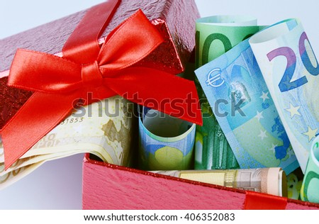 Euro banknote money gift on red box  . - stock photo