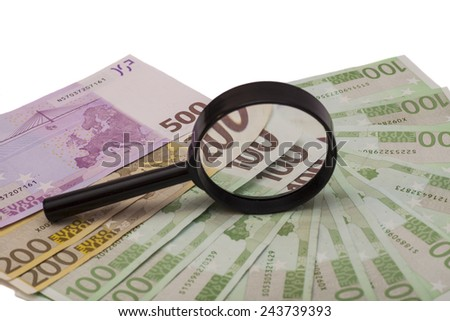 Euro banknote under magnifying glass on white  - stock photo