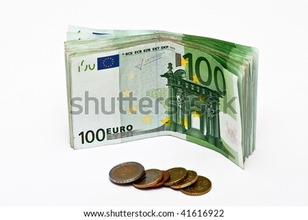 Euro banknotes an coins isolated on white - stock photo