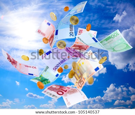 Euro banknotes and coins falling from blue sky - stock photo