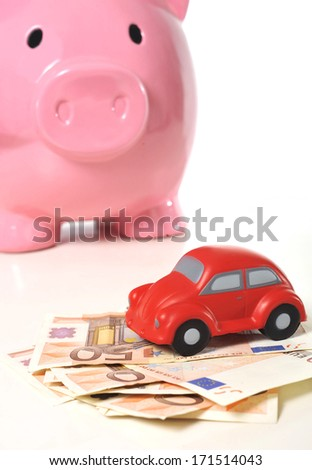 Euro banknotes and miniature car  isolated on white background representing saving to buy a new automobile - stock photo