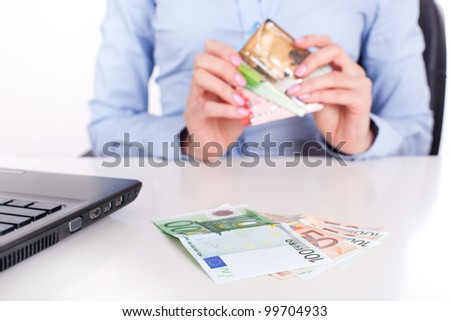 Euro banknotes closeup and credit cards in business woman hands, sitting in office - stock photo