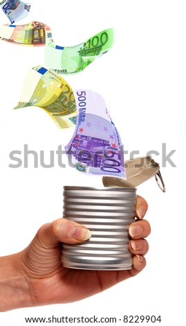 euro banknotes flying into a food can held by a female hand - stock photo
