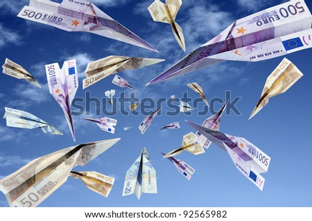 euro banknotes flying on blue sky - stock photo