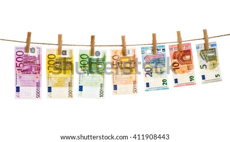 Euro banknotes hanging a rope with clothes pins. Money background. Money laundering concept - stock photo