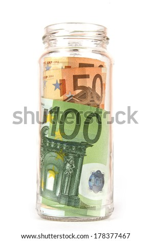 Euro Banknotes in glassy jar isolated in white  - stock photo