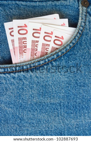 euro banknotes in jeans pocket - stock photo
