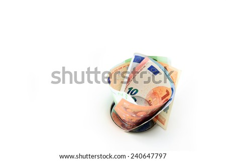 Euro banknotes in sink expressing the idiom 'pouring money down the drain' - stock photo
