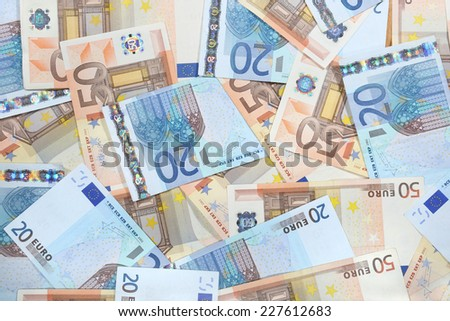 Euro banknotes laid out evenly. Financial background - stock photo