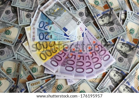 Euro banknotes on a background of one hundred dollar american banknotes - stock photo