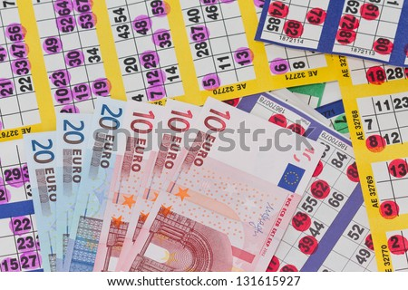 Euro Banknotes on Colorful Bingo Cards - stock photo