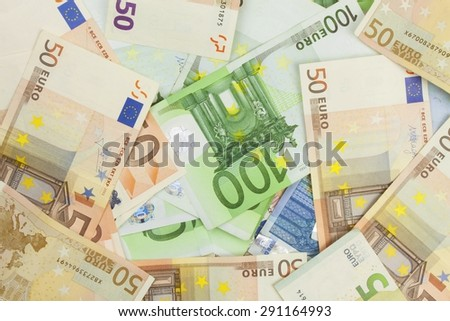 Euro banknotes scattered on the table. Background made with valid euro banknotes. - stock photo