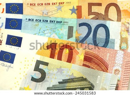 Euro banknotes Some small euro banknotes are spread.  - stock photo