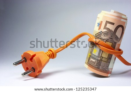 Euro banknotes tied into an outlet - stock photo