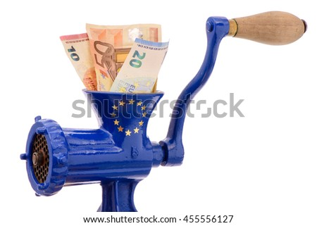 Euro banknotes while destruction in mincer as symbol for inflation or financial mismanagement - stock photo
