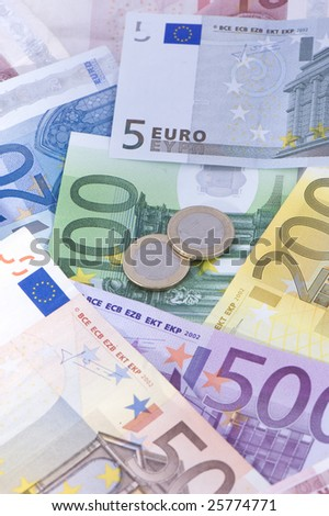 Euro banknotes with coins, can be used as a background - stock photo