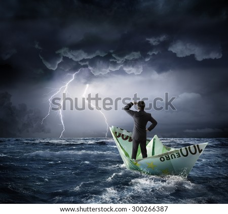 Euro boat in the bad weather - crisis concept - stock photo