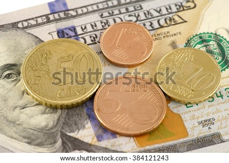 euro cents on the hundred dollar bill - stock photo