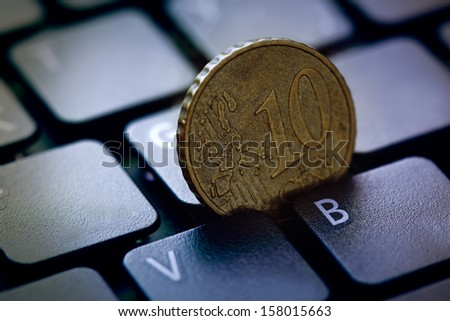 Euro coin in computer keyboard. Finance concept. - stock photo