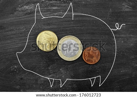 Euro coin into a piggy bank - stock photo