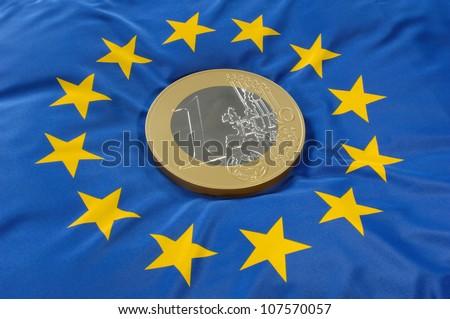 Euro coin on a european flag - stock photo
