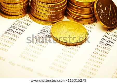 Euro coin on a paper with fiance date. Selective focus. - stock photo