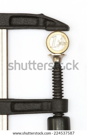 Euro coin squeezed in a clamp - stock photo