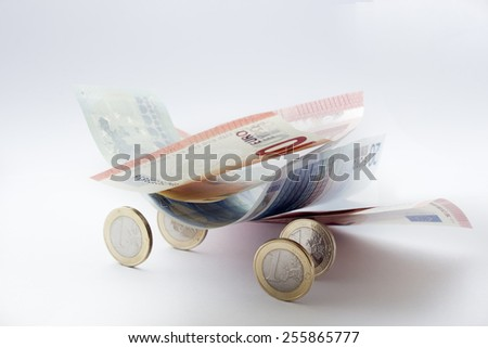 Euro coins and a blurry euro banknotes  in a white background - stock photo