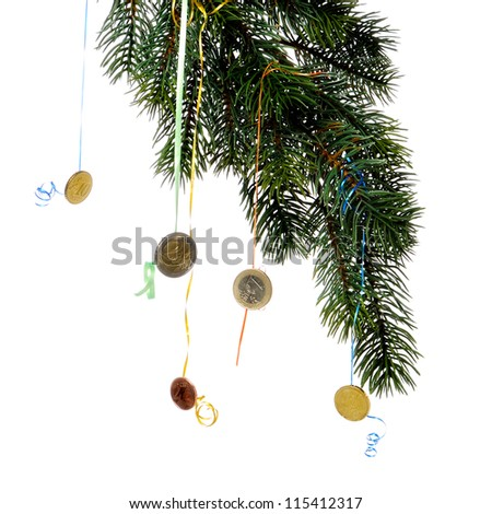 euro coins hanging on christmas tree branch on white background close-u - stock photo