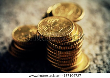 Euro coins in dark style. Very small depth of field. - stock photo