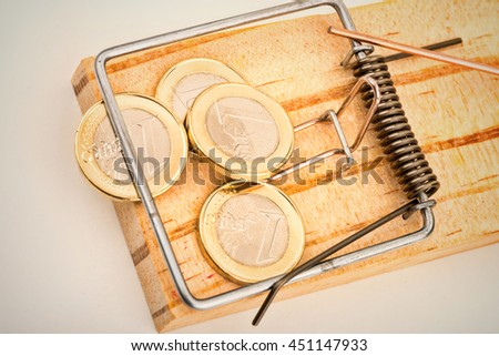 Euro coins on a mouse trap, a concept representing the current troubles of the European currency - stock photo