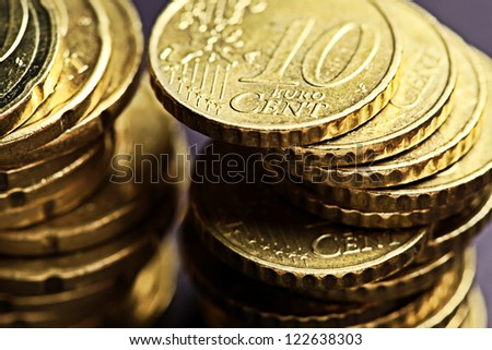 Euro coins on black background. Very small depth of field. - stock photo