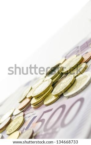 Euro coins on Euro banknotes. Copy space. - stock photo