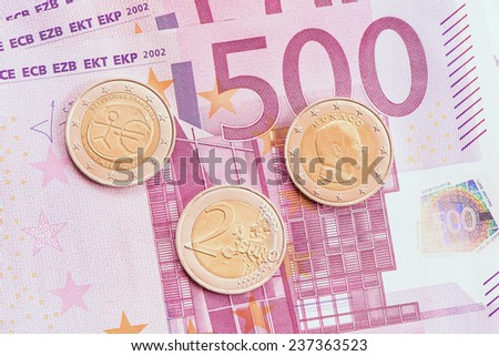 Euro coins on five hundred euro banknotes background.  - stock photo