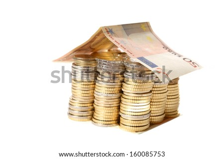 Euro Coins pile House with banknote roof  isolated on white background - stock photo