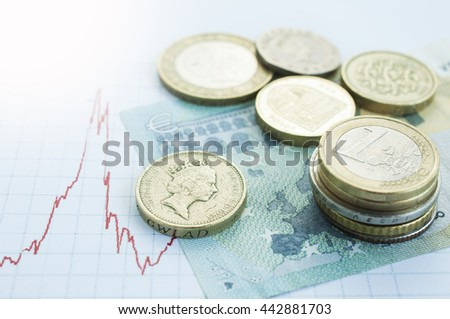 Euro coins piles on Europe map with British pound sterling coins Brexit crisis - stock photo