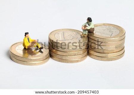 Euro coins with one euro with two humans - stock photo